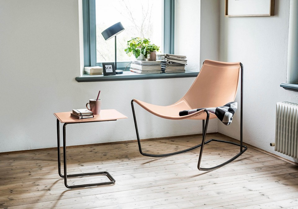 Apelle rocking chair with metal legs and pink hide seat