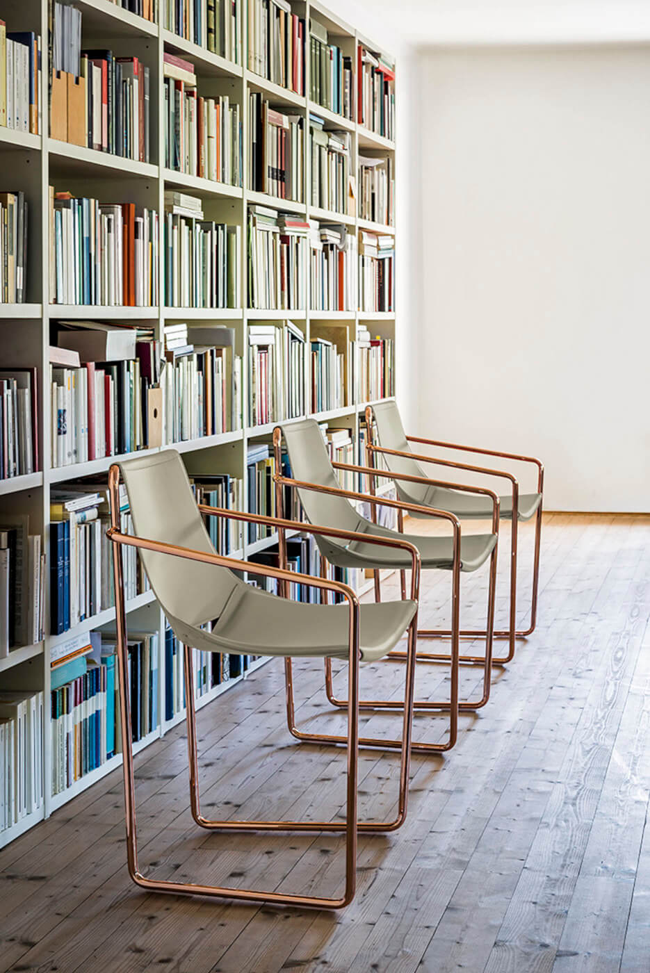 Apelle armchair with gray hide seat and pink gold legs