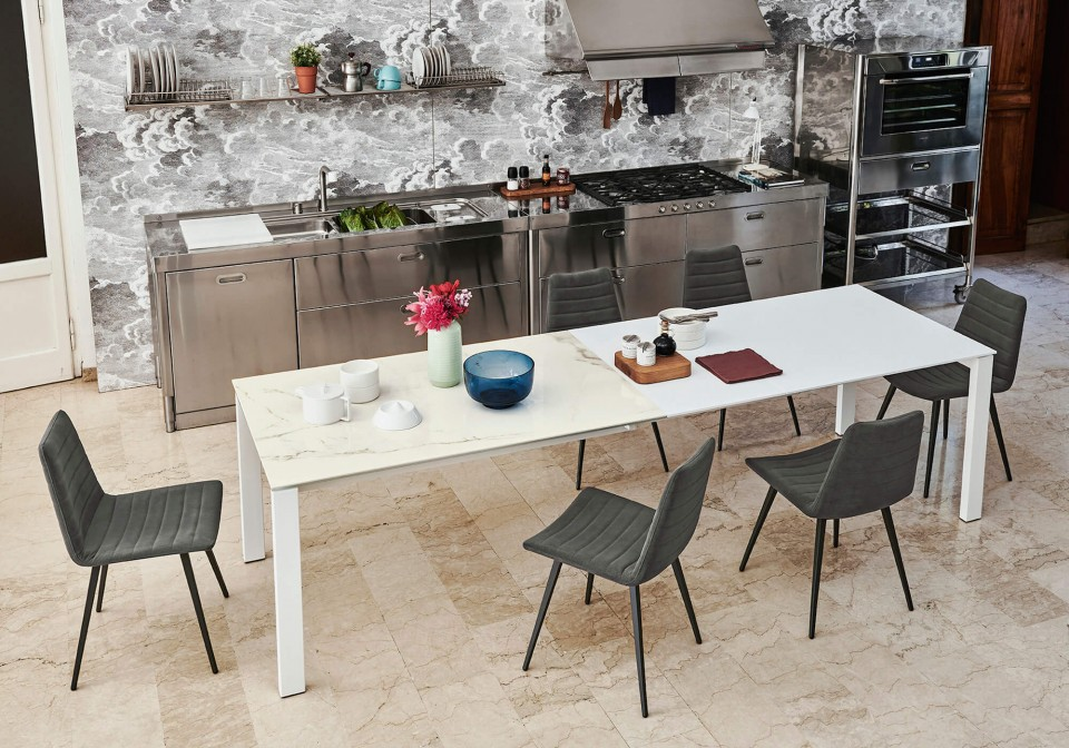 Badù extendable table with white crystalceramic top. Extensions in opaque white MDF