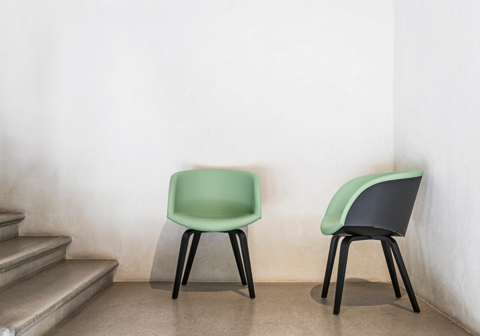 Danny armchair with black wood shell back and green leather seat