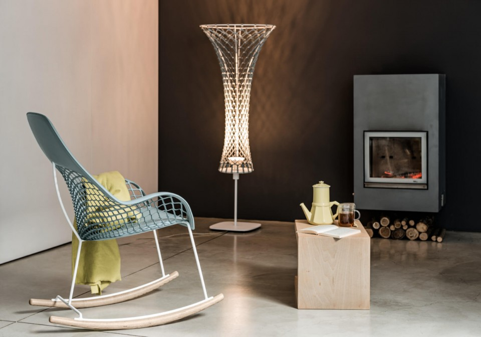 Guapa rocking chair with green hide seat and metal base
