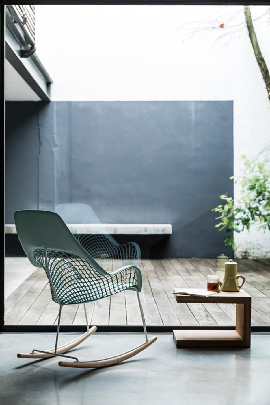 Guapa armchair with high back in green hide and metal structure
