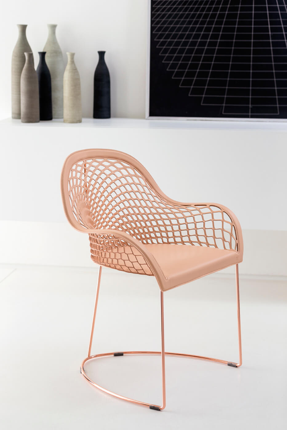 Guapa armchair with rose gold-finished metal frame and pink hide seat