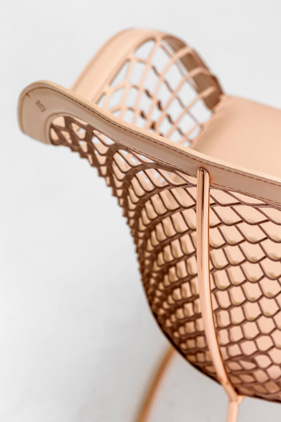 Guapa detail with metal frame and back in pink hide