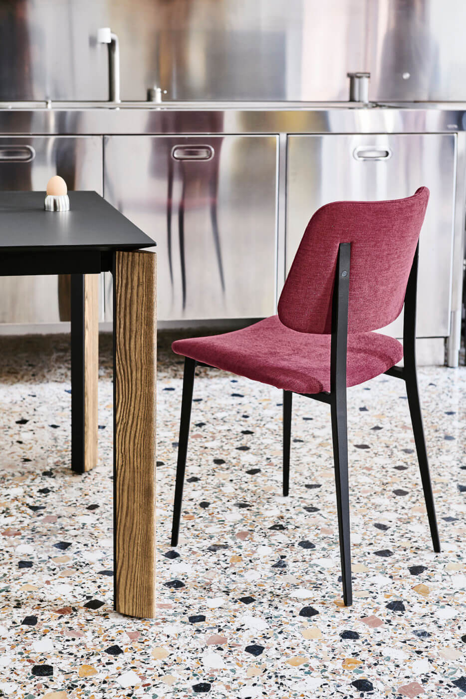 Joe chair with red fabric seat and black metal base