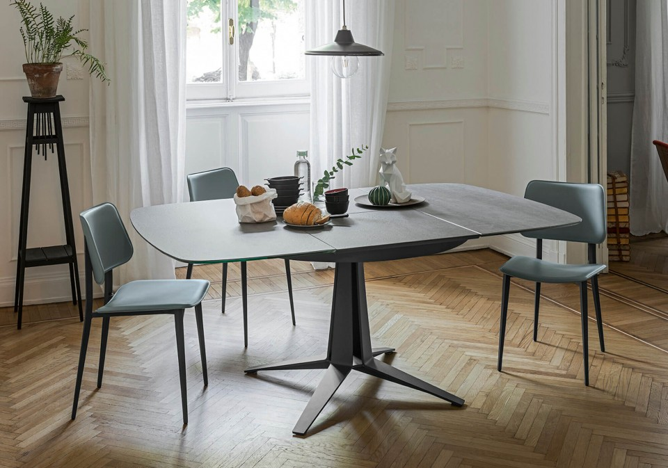 Link extendable table with central base in graphite metal and barrel top in cristalceramic with Savoy stone effect