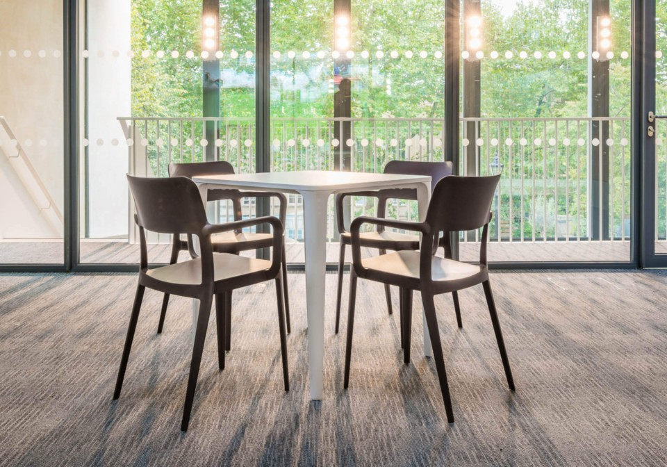 Nenè table chair with armrests in gray polypropylene