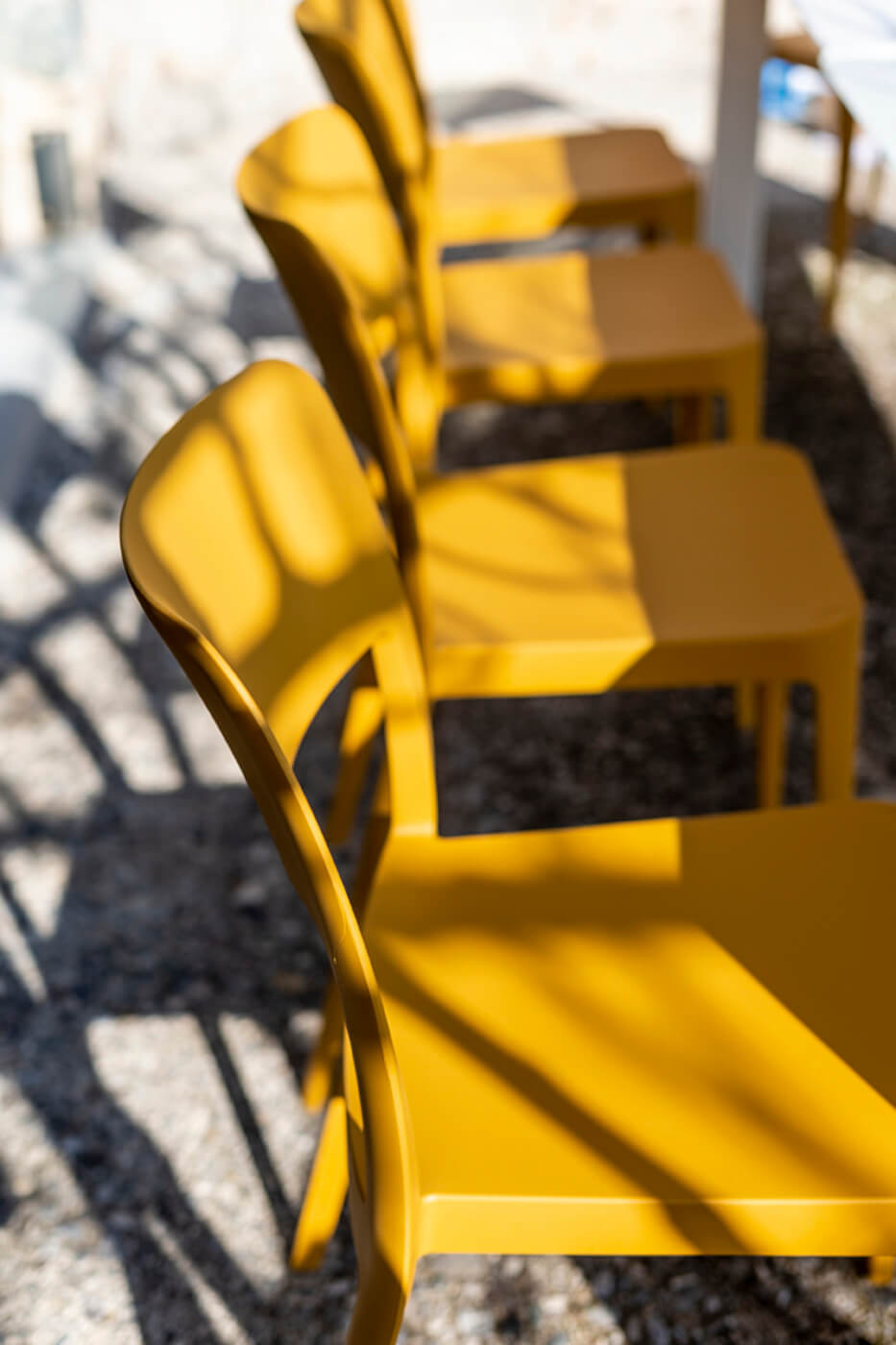 Detail of the seat of the Nenè chair, in ocher polypropylene