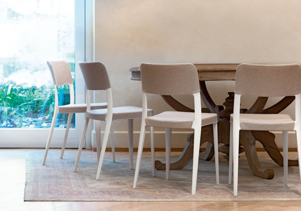 Nenè chair in white polypropylene with gray fabric covering