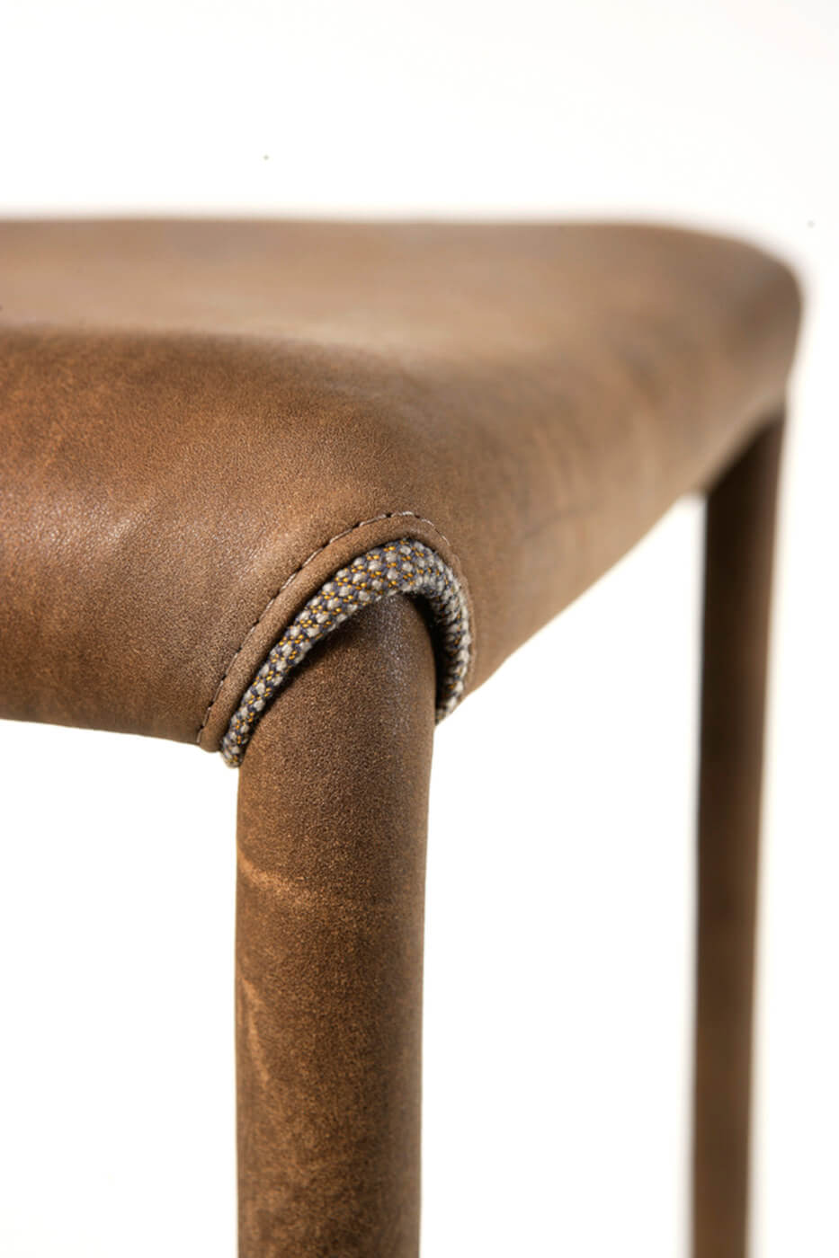 Nuvola chair detail with seat and legs covered in brown leather