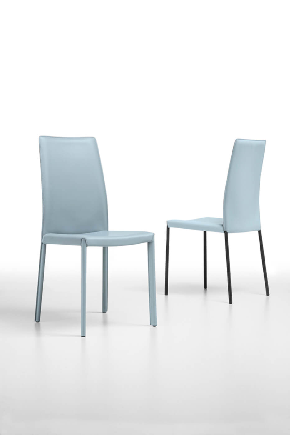 Nuvola chair with high back in light blue hide