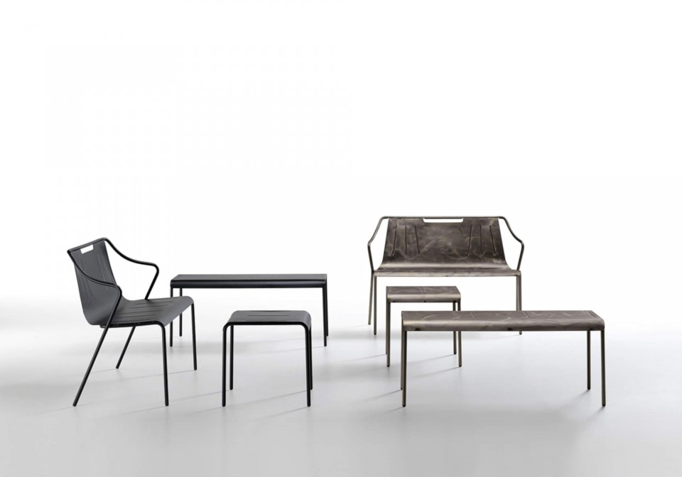 Ola bench in two versions: black painted steel and industrial effect