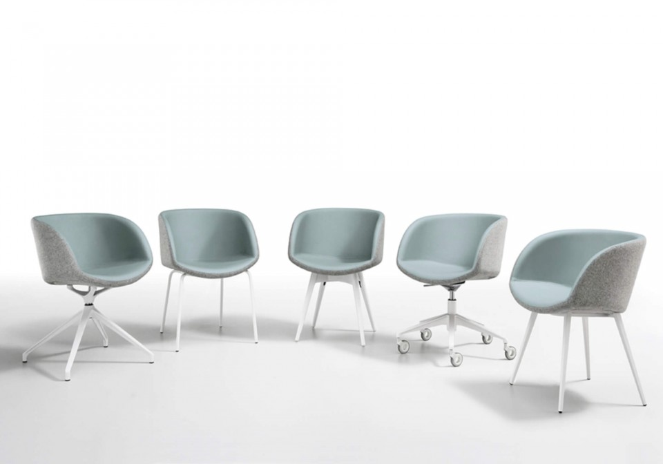 Sonny armchair with blue leather seat and gray fabric back shell.
