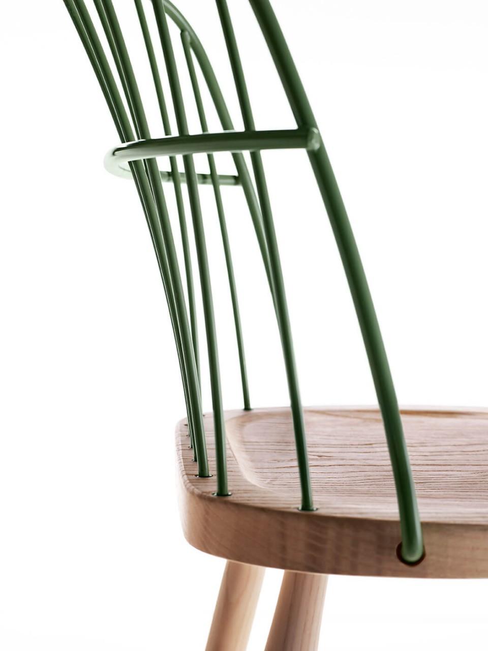 Strike chair back detail in green painted metal