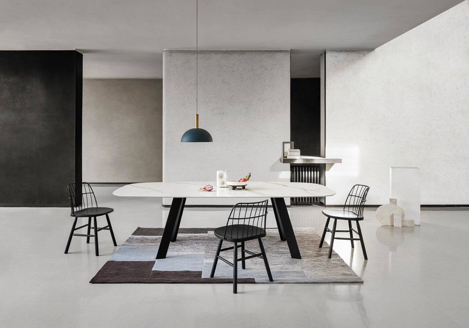 Strike dining table chair with black painted wooden structure and black metal back