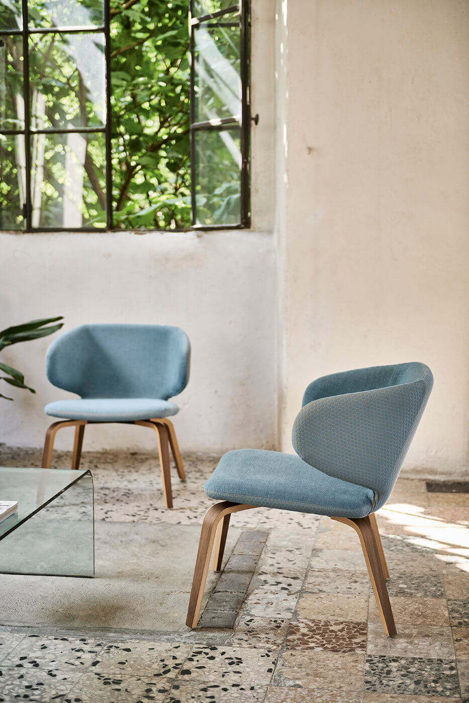 Waiting chair wrap with legs in flamed walnut and seat covered in light blue fabric