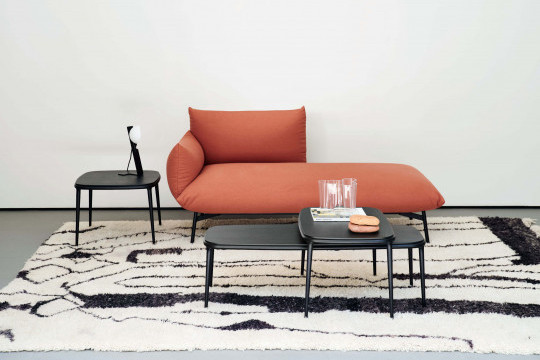 Lea coffee table with black wooden top.