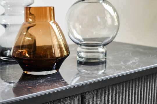 Detail of the marble-effect ceramic top of the Lea sideboard