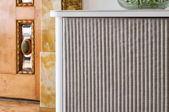 Detail of the doors covered in white fabric of the Lea sideboard