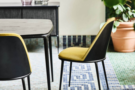 Lea chair with green upholstery and wooden back face