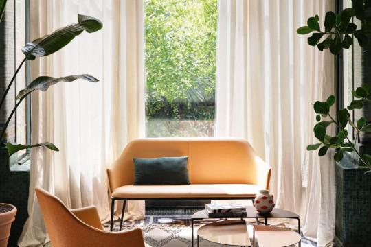 Lea sofa in orange fabric and leather