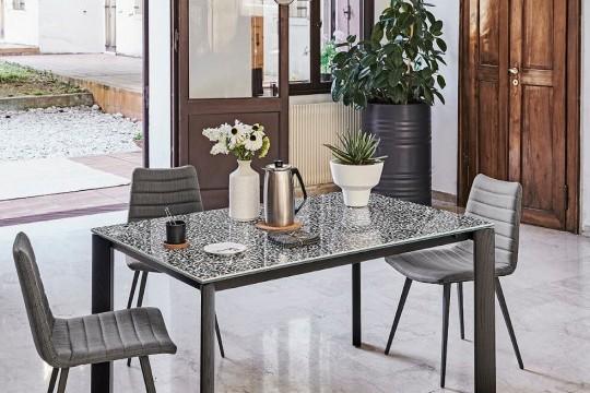 Blade dining table with black metal frame, legs in black wood and top in Venetian crystalceramic