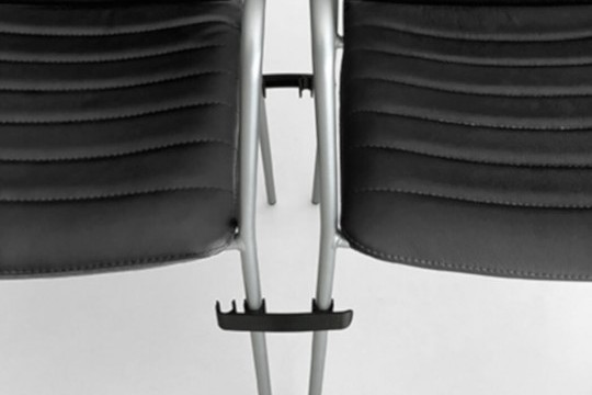 Detail of the Cover chair's finish, with black fabric seat
