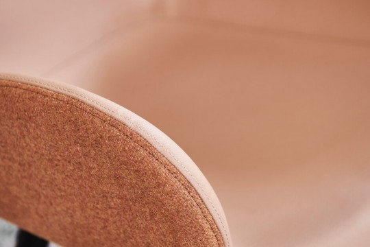 Detail of Dalia armchair with seat in fabric and pink hide