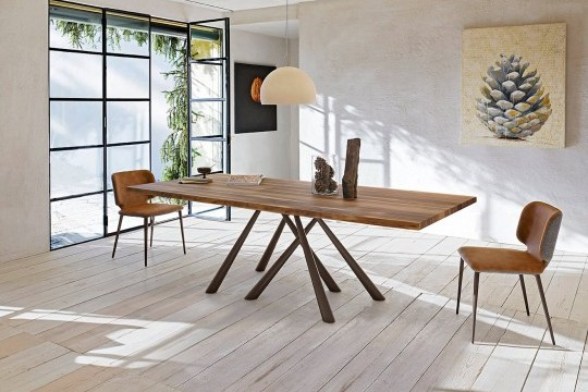 Forest table with brown metal base and solid walnut top with bark effect edge