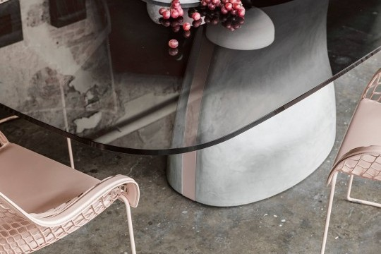 Detail of Gran Sasso's base with brushed concrete effect and pink metal insert