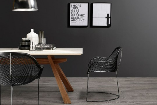 Guapa design armchair with black hide seat and black metal frame