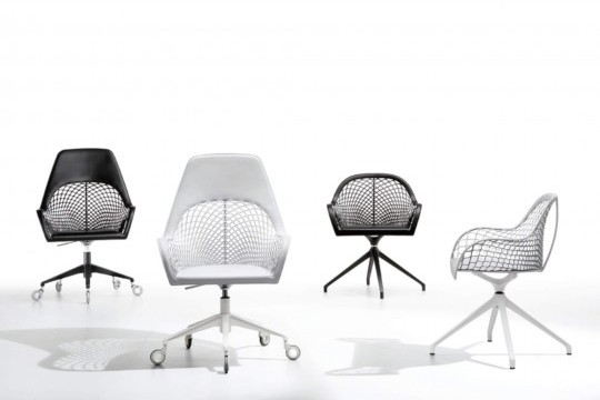 Guapa swivel armchair with black and white hide seat and black and white metal base
