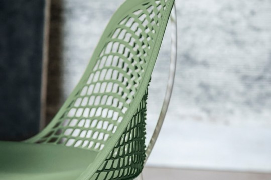 Guapa chair detail with green leather seat and metal structure