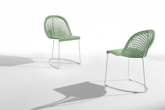 Guapa chair with metal frame and green leather seat