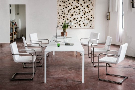 H5 table chair with padded seat covered in white fabric. Metal structure