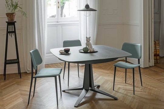 Joe table chair with blue hide seat and metal base