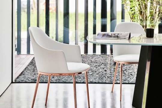 Lea armchair with steel legs in glossy pink gold finish, seat upholstered in white leather