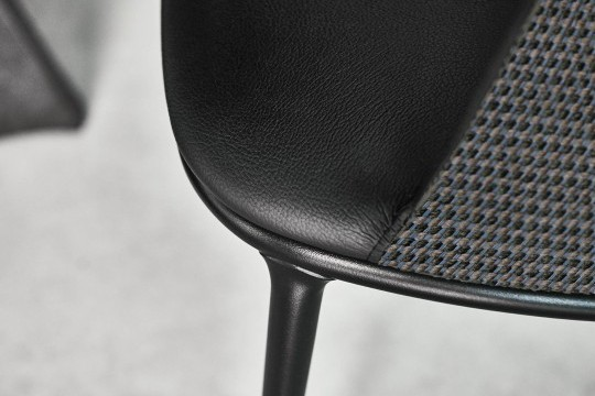 Detail of Lea chair with black frame, leather and fabric