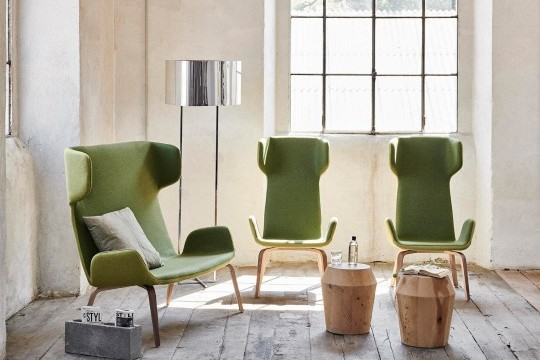 Light sofa with wooden base structure and green fabric seat