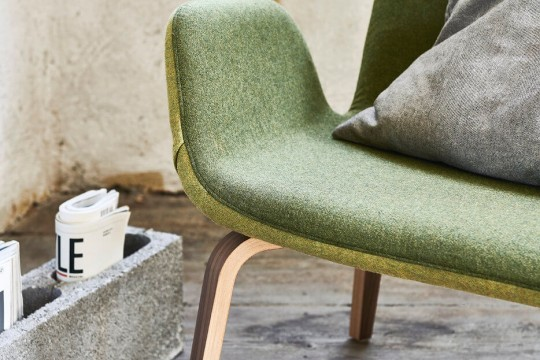 Particular Light armchair with green fabric seat and wooden base. The model has a back in light green fabric