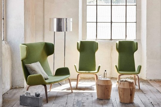 Light chair with armrests with green fabric seat and wooden base