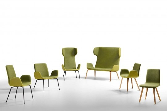 Light chair with seat covered in green fabric and wooden base