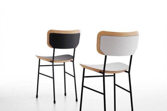 Master chair with black and white wood seat and metal structure