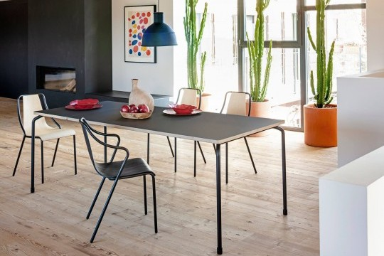 Master extendable table with four-leg base in black steel and top in black fenix