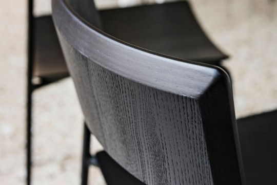 Detail of the Mito chair with black wooden seat