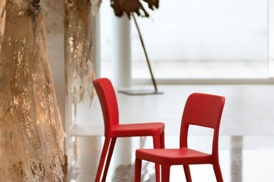 Nenè chair with four legs structure and covered in fabric