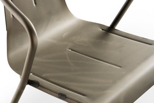 Detail of Ola armchair in industrial steel effect