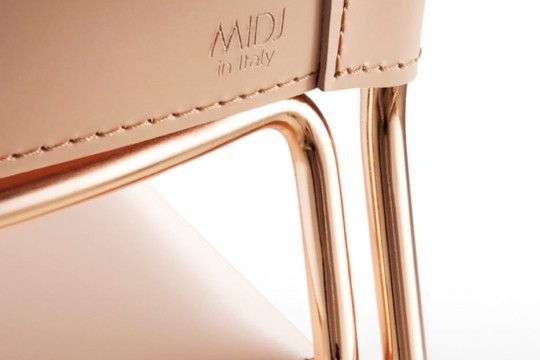 Detail of Slim back chair back with pink hide seat and metal base