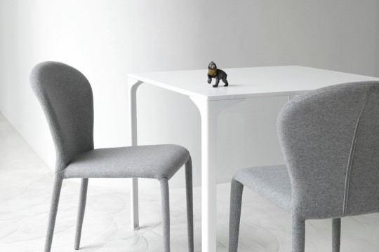 Soffio chair entirely covered in gray fabric