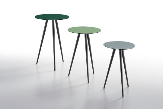 Complete collection of Trip coffee tables with black metal base and green leather tops in different shades